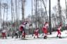 Спортсменки из России Кристина Кускова, Полина Некрасова и Диана Голован (справа налево) во время масс-старта на 15 километров свободным стилем среди женщин на соревнованиях по лыжным гонкам.
