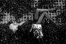 Ева Джей Кубатова — чешская модель, представительница «восточноевропейской волны» манекенщиц. Лорье заставил экстравагантную блондинку в соблазнительных чулках принять максимально раскованную позу, напоминающую позы танцовщиц легендарных парижских кабаре. Отражающийся в зеркале мужчина с максимально невозмутимым выражением лица — словно персонаж «Постороннего» Камю.