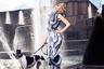 В этой композции нельзя не отметить не только профессионализм фотографа, но и остроумие стилиста: изысканные изгибы тела собаки перекликаются со столь же прихотливым абрисом экстравагантных ботильонов модели.