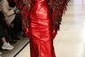 Об одежде от Катерины Кошкиной можно спорить, но ее показ явно запомнится зрителям: визажист постарался на славу, и лицо модели было полностью закрашено красным гримом.