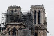 Firefighters work at Notre-Dame Cathedral in Paris, France, April 16, 2019. A massive fire consumed the cathedral on Monday, gutting its roof and stunning France and the world.  REUTERS/Benoit Tessier - RC1424844C00