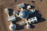 Вид на базу C-Space Project с дрона. База состоит из девяти отсеков: пункт управления, центр переработки, склад, биомодуль, медицинский центр, спальный модуль, ванная, шлюзовая камера, а также блок для фитнеса и досуга.