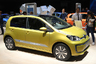 """e-Up — первый серийный электрический городской автомобиль от Volkswagen, который был представлен в 2013 году. Это «зеленый» вариант модели Volkswagen Up!, запущенной в производство в 2012-м.  <br></br> Модель e-Up <a href=""""https://topgearrussia.ru/news/11232_volkswagen_pokazal_elektricheskiy_e_up"""" target=""""_blank"""">разгоняется</a> до «сотни» за 14 секунд и может двигаться с максимальной скоростью 135 километров в час. Без дополнительной подзарядки этот автомобиль преодолевает 150 километров, а до 80 процентов его можно зарядить всего за 30 минут."""