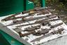 """Впрочем, тайники с оружием находят не только в частных домах и квартирах. В том же сентябре 2013 года рязанские спасатели <a href=""""https://www.ryazan.kp.ru/online/news/1539870/"""" target=""""_blank"""">получили</a> сигнал из детского сада №20. Рабочие нашли в земле схрон с оружием. Там были ржавые сабли, штык-ножи, наганы, патроны и сигнальный пистолет-ракетница, а также магазинные коробки от старых винтовок типа «Лебель», «Арисака» и «Манлихер». Все находки относились к периоду Первой мировой войны. <br></br> Здание детского сада (дом №19 по Первомайскому проспекту) относится к ансамблю «Жилые общественные здания второй половины XIX века» и находится под охраной областного правительства. Тайник с оружием столетней давности уже не первая находка. Примерно 40 лет назад работники детсада решили сделать песочницу во дворе, но, сняв верхний слой грунта, наткнулись на загадочный люк. Прибывшие на место сотрудники милиции и «люди в штатском» выяснили, что под детским садом находится что-то вроде бункера. Кто его строил и что с ним будет дальше, компетентные органы не сообщили, а песочницу строить запретили, но разрешили поставить дощатый домик, который стоит там и сегодня."""