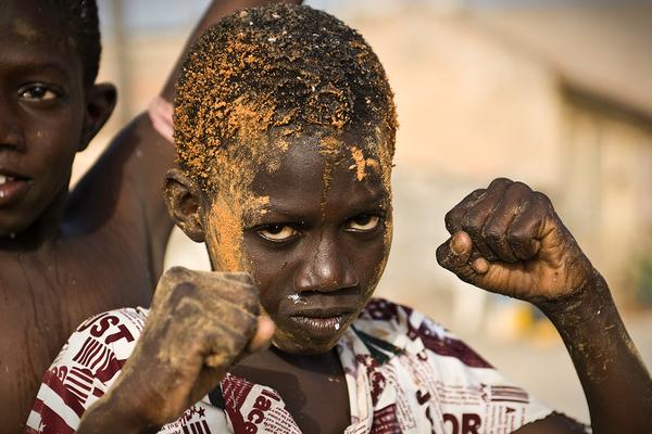 SAINT LOUIS, SAINT-LOUIS, SENEGAL - 2010/04/09: Senegalese boy pretending to be a boxer. (Photo by Jorge Fernández/LightRocket via Getty Images)