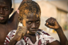 SAINT LOUIS, SAINT-LOUIS, SENEGAL - 2010/04/09: Senegalese boy pretending to be a boxer. (Photo by Jorge Fernández/LightRocket via Getty Images)