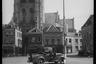 Американский армейский автомобиль на одной из улиц города. Нидерланды, 1944 год.