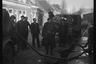 Забор питьевой воды для армейских нужд из уличного брандспойта. Нидерланды, 1944 год.