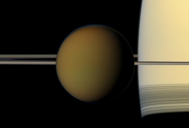 Titan Upfront The colorful globe of Saturn's largest moon, Titan, passes in front of the planet and its rings in this true color snapshot from NASA's Cassini spacecraft.