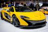"""Выпуск McLaren P1 был начат в 2013 году. Он <a href=""""https://www.forbes.com/sites/joshmax/2015/12/10/its-all-over-for-the-1155000-mclaren-p1/"""" target=""""_blank"""">стал</a> первым суперкаром в мире, оснащенным гибридной силовой установкой. Всего было собрано 375 экземпляров этой модели стоимостью около миллиона евро каждый. Суммарная мощность гибридной силовой установки McLaren P1 составляет 916 лошадиных сил. До 100 километров в час автомобиль разгоняется за 2,8 секунды, а его максимальная скорость ограничена электроникой на отметке 350 километров в час. С производства суперкар был снят в конце 2015 года."""