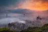 Практически каждое весеннее утро Гонконг тонет в тумане, щедро раскрашенном яркими цветами восходящего солнца. Десятки фотографов ежедневно отправляются в горы, чтобы запечатлеть величественную картину. Увы, глобальное потепление может лишить нас этой красоты. По мере того, как зимы становятся теплее, холодный воздух с севера все реже достигает города весной.