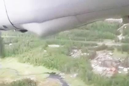 Пассажир Ан-24 снял жесткую посадку самолета на видео