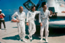 Пилот лунного модуля Базз Олдрин, командир экипажа Нил Армстронг и пилот командного модуля Майкл Коллинз у пилотируемого космического корабля Apollo 11.