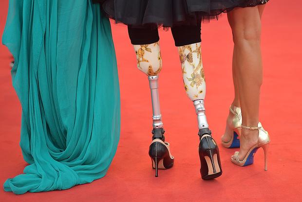 Паралимпийская спортсменка Джузеппина Версаче (в центре) — частый гость Венецианского кинофестиваля.
