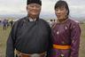 Олег Хертек, глава администрации пограничного с Монголией Эрзинского кожууна (района), и его заместительница Байырма Ижигин в национальных костюмах на ежегодном празднике Наадым.