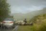 Чабан со стадом овец переходит через шоссе под проливным дождем. После сооружения в 1980-е годы Саяно-Шушенской ГЭС на Енисее, по наблюдениям жителей западных районов Тувы и экологов, здесь серьезно изменился климат — он стал более теплым и влажным, с частыми внезапными ливнями.  <br><br> Еще одним инфраструктурным последствием строительства плотины для Тувы стало перекрытие единственной водной артерии, соединявшей ее с остальной Россией, а также затопление нескольких населенных пунктов и пастбищ.