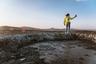 Рядом с Гобустаном находится уникальная территория с грязевыми вулканами. Есть вулканы высотой ниже взрослого человека, а есть представляющие собой холмы в несколько метров, на которые нужно взбираться, чтобы заглянуть в кратер.  <br></br> Вулканы активны, густая грязь лениво бурлит и надувается  пузырями, разбрызгиваясь по сторонам. Вулканическая грязь считается лечебной, поэтому при желании можно ею намазаться, но не стоит забывать, что она холодная. Так как в этой местности имеются нефтегазовые месторождения, вулканы извергают не только грязь. Некоторые извержения сопровождаются взрывами газоконденсата, пламенем и подземным гулом.