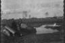 Полицейские позируют у подбитого советского танка КВ-1 («Клим Ворошилов»). Западная Украина, 1941-1942 годы.