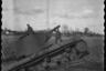 Полицейские позируют у подбитого советского танка КВ-2. Западная Украина, 1941-1942 годы.