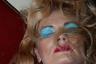 Если героини предыдущего снимка привлекали внимание одеждой леопардовой расцветки, то в портрете Марины, следующей поездом Одесса— Киев, явный акцент делается на косметике. О городе, расположенном на берегу Черного моря, напоминает выбор голубого цвета макияжа. В снимках Julie Poly заметны оттенки эротической фотографии.