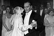 circa 1925:  Guests clustered in a doorway watch as Mustafa Kemal Ataturk, President of the Turkish Republic, dances with his adopted daughter at her wedding.  The gesture demonstrated both his policy of Westernisation and Satisation (a deliberate Anti-Islamic line).  (Photo by Hulton Archive/Getty Images)