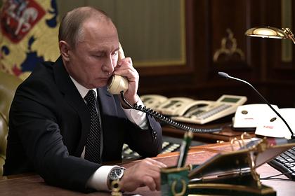 Путин обсудил с Меркель судьбу Украины