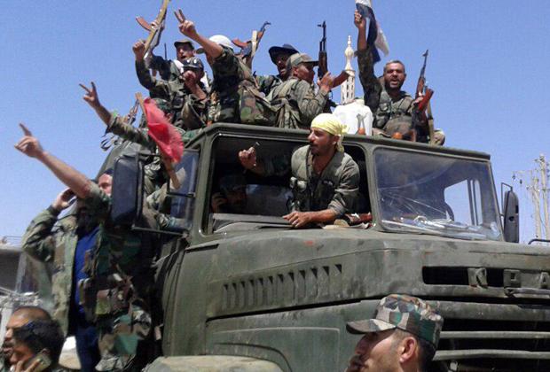 Подконтрольные президенту Асаду вооруженные силы в городе Бусра аль-Харир на севере провинции Дераа