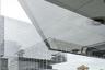 """Арт-центр Guardian Art Center построен в Пекине по проекту немецкого архитектора Оле Шерена. Вокруг много зданий в традиционном китайском стиле. Автор снимка свою задачу видел в том, чтобы доказать: старое и новое могут мирно сосуществовать. «Наконец-то мы видим здания разных поколений в едином обрамлении, — <a href=""""https://www.photocrowd.com/photos/guardian-art-center-beijing-buro-ole-scheeren-3280598.2e6462f9f/"""" target=""""_blank"""">радуется</a> он. —  После десятилетий сноса и реконструкции китайский подход к урбанизации сильно изменился»."""
