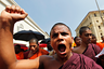 A Sri Lankan Buddhist monk shouts slogans outside the Indian High Commission to Sri Lanka during a protest in Colombo March 20, 2013. Buddhist monks protested since Tuesday against two separate attacks on Sri Lankan Buddhist monks who were in Chennai for education visits, and demanded the Indian government to take action on these attacks, according to the demonstrators. REUTERS/Dinuka Liyanawatte (SRI LANKA - Tags: POLITICS CIVIL UNREST RELIGION) - GM1E93K18HZ01
