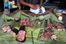 Прилавки рынков Мбандаки ломятся от мяса диких животных. Здесь можно найти куски крокодилов и варанов, только что забитых обезьян, ноги лесных антилоп.