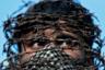 Мужчина в маске из колючей проволоки участвует в акции протеста после пятничной молитвы из-за ограничений, введенных отменой специального статуса для штата Джамму и Кашмир. Сделанное 11 октября в городе Сринагар фото иллюстрирует реакцию местного населения на решение властей Индии. 5 августа Нью-Дели официально упразднил штат и перевел его в две союзные территории, имеющие меньше прав. Индийский парламент отменил 370-ю статью конституции, наделявшую Кашмир особым статусом. Из-за этого обострились отношения Индии и Пакистана. Джамму и Кашмир в настоящее время остается единственной индийской территорией, где большинство населения — мусульмане.
