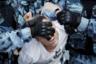 Сотрудники силового ведомства задерживают участника акции 27 июля за допуск независимых кандидатов на выборы в Мосгордуму. Столичный избирком отказал в регистрации нескольким претендентам на основании того, что они не собрали необходимое количество подписей или собрали с нарушениями. В ходе несогласованной акции в центре Москвы полиция задержала свыше тысячи человек. Следственный комитет возбудил уголовное дело о массовых беспорядках и несколько дел о применении насилия в отношении сотрудников правоохранительных органов. Массовыми беспорядками акцию 27 июля назвал и мэр столицы Сергей Собянин. Тогда занимавший пост главы Совета по правам человека (СПЧ) Михаил Федотов сообщил, что у него есть претензии и к организаторам акции, и к силовикам, которые действовали очень грубо. Судебные процессы над задержанными получили название «московское дело». Уголовные дела были заведены в отношении 30 человек.