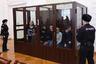 """Московский окружной военный суд (МОВС) 10 декабря вынес приговор по делу о теракте в метро Санкт-Петербурга 3 апреля 2017 года. Тогда погибли 15 человек и 67 получили ранения. <br></br> 11 обвиняемых из запрещенной в России группировки «Катиба Таухид валь-Джихад», связанной с террористической организацией «Аль-Каида» (также запрещена в России), получили сроки от 19 лет до пожизненного заключения. Максимальное наказание получил Аброр Азимов. Единственная женщина среди подсудимых — Шохиста Каримова — получила 20 лет колонии.  <br></br> По версии обвинения, 22-летний террорист-смертник Акбаржон Джалилов взорвал себя в вагоне поезда на перегоне между станциями «Технологический институт» и «Сенная площадь». В подготовке теракта ему помогали 11 сообщников, при этом самыми активными участниками группы следствие называет братьев Аброра и Акрама Азимовых.  <br></br> В начале судебного процесса подсудимые <a href=""""https://lenta.ru/news/2019/04/04/protest/"""" target=""""_blank"""">устроили</a> акцию протеста, прислонив к стеклам изолирующего бокса плакаты с надписями: «Нас подставили», «Мы невиновны» и «Вы увидите, что на нас ничего нет». <br></br> В суде они заявили, что были вынуждены оговорить себя под пытками в «секретной тюрьме ФСБ». 31-летний уроженец Киргизии Акрам Азимов <a href=""""https://lenta.ru/news/2019/09/19/azimov/"""" target=""""_blank"""">рассказал</a>, что его задержали на больничной койке в Киргизии и тайно вывезли в Москву, где четыре дня избивали и пытали током, приковав наручниками к батарее."""