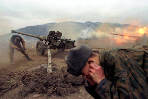 Russian soldiers fire artillery at rebel positions near the village of Duba-Yurt, 30 kilometers (18 miles) south of the capital Grozny, Saturday, Jan. 22, 2000. Russian troops battled Islamic rebels Sunday in increasingly intense war for control of Grozny, military officials said. (AP Photo/Maxim Marmur)