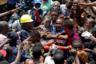 Мужчины несут Адемолу Аянболу, спасенного на месте рухнувшего здания школы в нигерийском Лагосе. Девятилетний ребенок находился в классе на верхнем этаже. Как вспоминают очевидцы, он лежал с широко раскрытыми глазами на носилках, покрытый белой пылью и с кровавой раной на голове, — и все громко радовались его спасению. Школьник же был абсолютно спокойным, не кричал и не рыдал. «Я просто плакал. Я ожидал смерти сына. Когда я наконец обнял его, я был так взволнован, так счастлив. Мне не придется нести его труп», — рассказал позднее его отец Фрэнсис Айанбола.