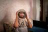 27-летняя жительница Марокко Фатимазехра Эль-Газауи страдает редким заболеванием под названием ксеодерма пигментная, известным также как прогрессирующий меланоз. При этом наследственном заболевании кожи чувствительность к ультрафиолетовому облучению усиливается и прогрессирует, поэтому всякий раз перед выходом на улицу девушке приходится надевать специальную защитную маску.