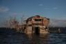 Деревня была сильно разрушена, когда на Филиппины в 2011 году пришел тайфун «Несат». Мартинес рассказывает, что на остров обрушилась волна размером с дом, хижины одну за другой утягивало в море. Разрушена была и местная школа: от нее остались одни лишь стены. После этого некоторые жители построили бамбуковые хижины поверх бетонных руин.