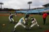 """Бейсбольный стадион Azuma Baseball Stadium, на котором будут проходить олимпийские матчи, расположен примерно в 70 километрах к западу от Футабы. Японские чиновники активно рассказывают, что он, как и футбольный J-Village, очищен от радиации. Однако в декабре 2019-го активисты Greenpeace <a href=""""https://lenta.ru/news/2019/12/04/radiacia/"""" target=""""_blank"""">сообщали</a> о наличии очагов радиации возле последнего. По данным организации, уровень радиации на поверхности доходит до 71 микрозиверта в час, когда безопасным считается до 0,5 микрозиверта в час."""