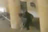 На кадрах, снятых очевидцами, видно, как нападавший в темной одежде прячется за колоннами дома и ведет огонь. На другом видео заметно, как два человека бегут по улице, после чего один из них падает в результате выстрела. Авторы ролика утверждают, что огонь вели по силовикам из-за колонн.