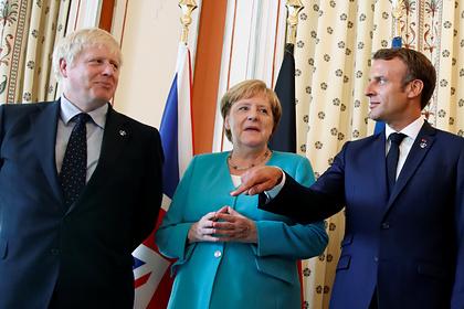 Премьер-министр Великобритании Борис Джонсон, канцлер Германии Ангела Меркель и президент Франции Эмманюэль Макрон