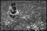 Супруга В. Крамера собирает цветы. Германия, 1942 год.