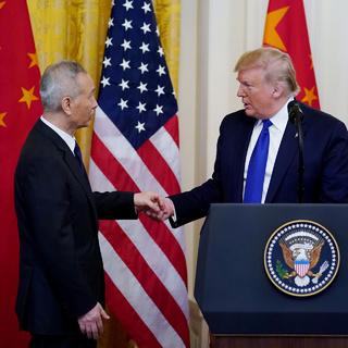 Лю Хэ и Дональд Трамп