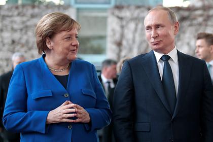 Путин и Меркель пообщались на русском языке