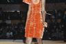 Одним из культовых творений Жан-Поля Готье стало оранжевое бархатное платье облекающего кроя с конусообразными элементами на груди. Автором фотосессии, которая впервые представила экстравагантный наряд публике, стал знаменитый фотограф Петер Линдберг. Снимки появились в журнале Vogue еще в 1984 году, однако истинную популярность этот силуэт обрел несколько лет спустя благодаря певице Мадонне.