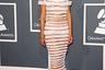 В платье Jean-Paul Gaultier выходила в свет и Рианна. При подготовке к церемонии «Грэмми» 2011 года выбор певицы пал на отнюдь не самое скромное творение дизайнера: ее тело в прозрачном платье со шлейфом прикрывали только горизонтальные полоски из белых оборок.