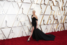 Американская актриса южноафриканского происхождения Шарлиз Терон появилась на красной ковровой дорожке «Оскара»-2020 в классическом черном платье Dior с небольшим шлейфом. Откровенности наряду добавил глубокий разрез на юбке, обнажающий ноги артистки, и кокетливо небрежное декольте, а роскоши — колье Tiffany High Jewelry с чистейшим 21-каратным бриллиантом огранки «маркиз» за пять миллионов долларов.
