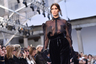 """На показе Max Mara Белла Хадид, самая красивая в мире женщина (как <a href=""""https://lenta.ru/news/2019/10/15/perfect/"""" target=""""_blank"""">показали</a> математические расчеты), выступила в весьма привычном для себя, повседневном образе. Она демонстрировала публике полностью прозрачную блузку из новой коллекции бренда и широкие бархатные брюки."""