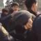 Милиционеры задерживают одну из участниц акции против насилия в Бишкеке