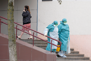 Medical employees wear protective suits as they leave a dormitory as a measure to fight against the coronavirus disease contagion (COVID-19) in Minsk, Belarus March 12