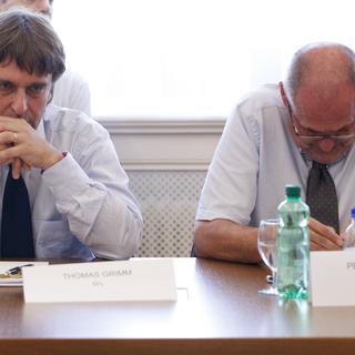 Томас Гримм (слева)